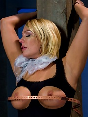 Big tittied blonde MILF gets shocked and made to cum.